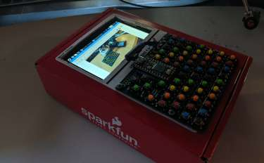 The handheld pi assembled as a single unit in a cardboard box