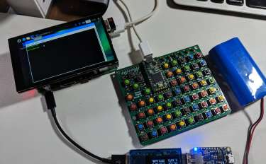 A photo showing the major components of the Handheld Raspberry Pi, screen, battery, and mini keyboard with rainbow buttons