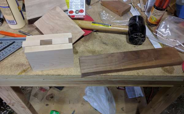 The cut pieces of the mallet.