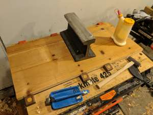 """A larger panel gluing up on the project center, with a section of railway track as a """"clamp"""""""