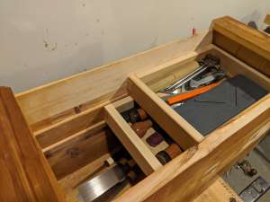 The toolbox with the trays installed. Both trays are slid away from the viewer, such that the bottom of the toolbox can be seen.