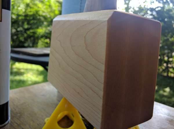 Closeup of the mallet striking surface finished with danish oil