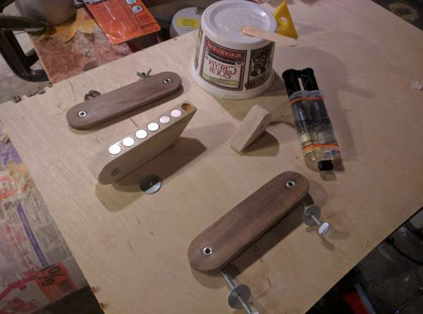 Gluing in the magnets with epoxy.