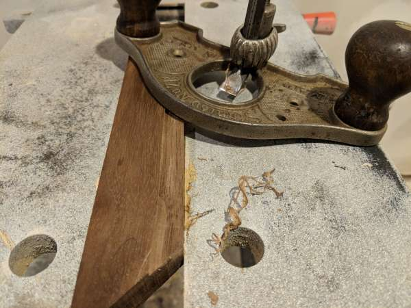 A router plane and a piece of the frame