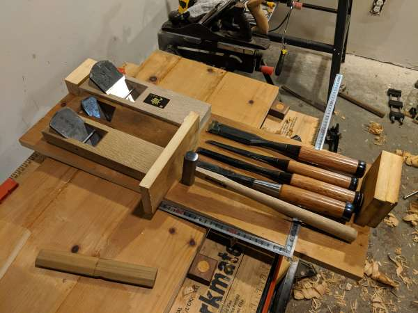 A test layout of the tools on the bottom of the box