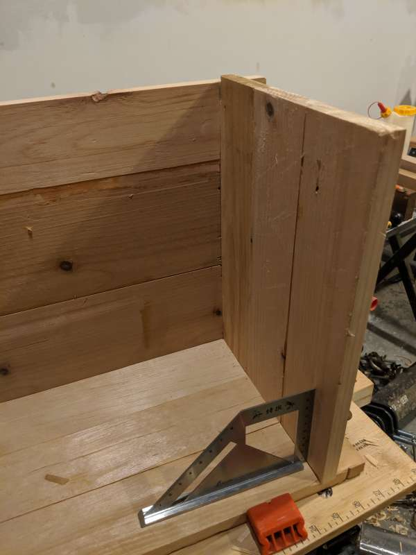 A dry fit of one of the corners of the box, with a corner square as a reference