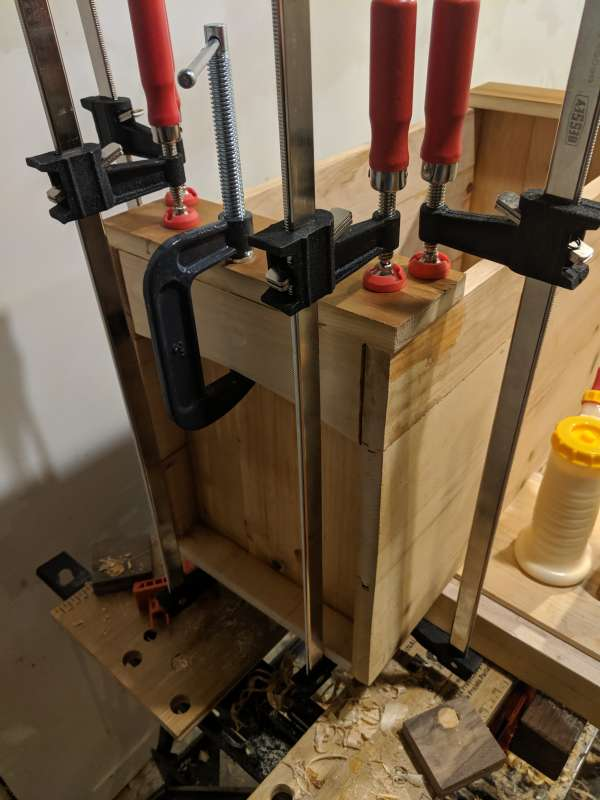 The top runners gluing onto the toolbox, using several C-clamps and bar clamps