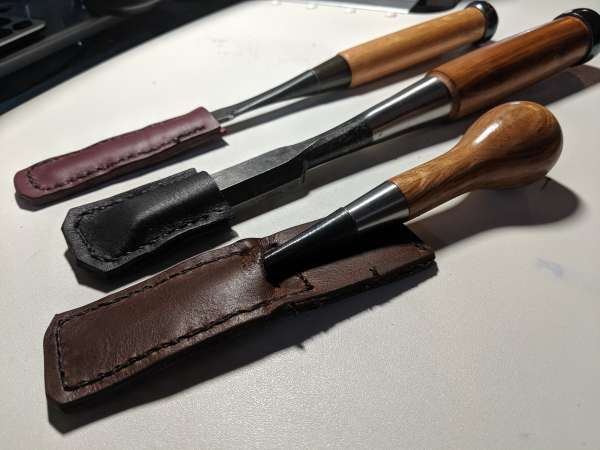 A selection of chisels in their new leather guards