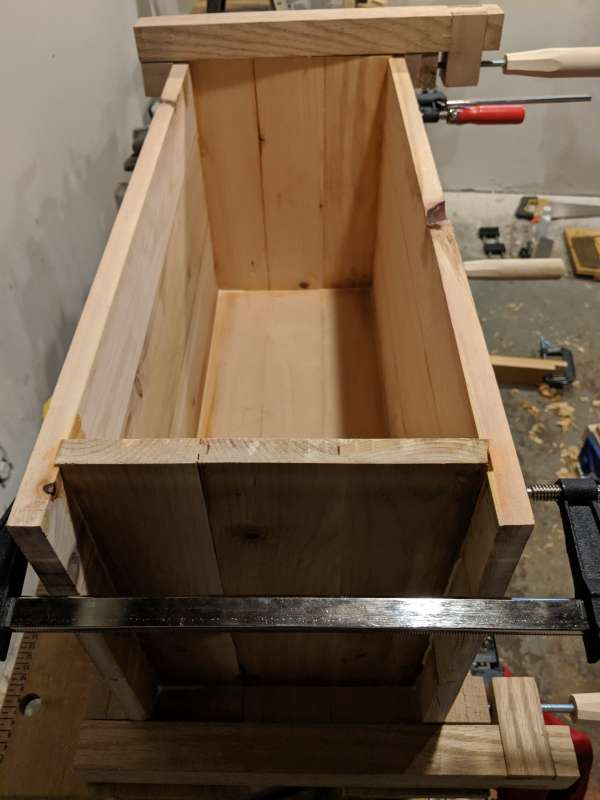 The toolbox clamped together for glueing, showing interior detail. The side panels are inset from the longer front and back of the box