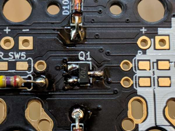 Once mounted on the board, the transistor was smaller than an 1/8th watt resistor