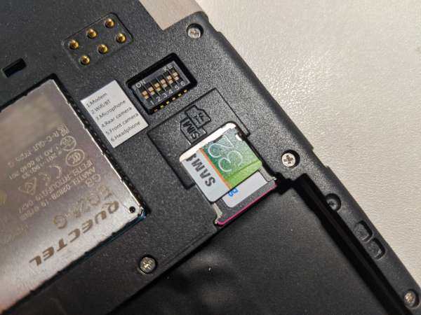 A close up of the MicroSD card slot and the switches