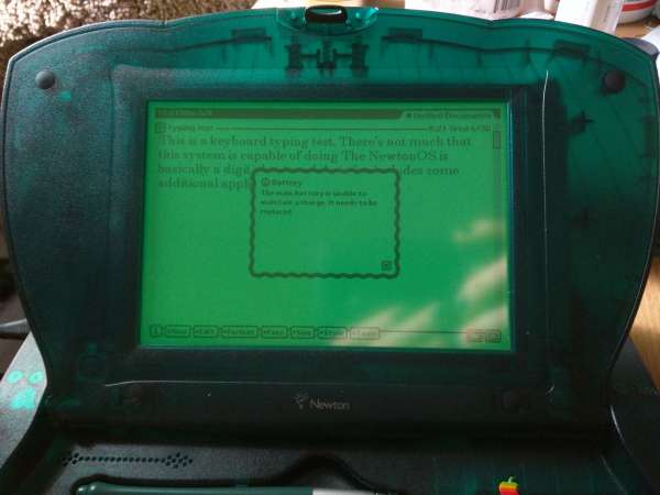 A closeup of the eMate's monocrome LCD screen, it glows a bright green