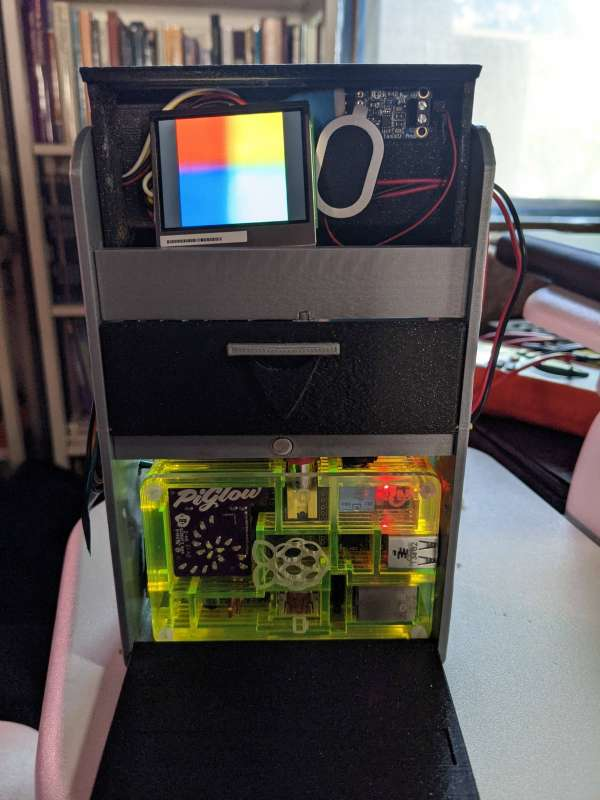 The pi inside the tricorder case, with the screen resting on the inside of the hood