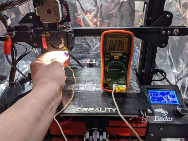 A multimeter takes a temperature reading from a printer hotend, it reads 30C colder than the printer's own reader